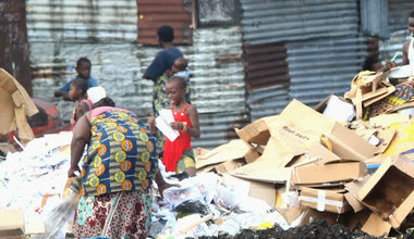 Women and their children looking for valuables in a trash dump in Kinshasa. Photo Radio Okapi /John Bompengo